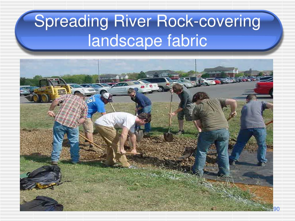 Spreading River Rock-covering landscape fabric