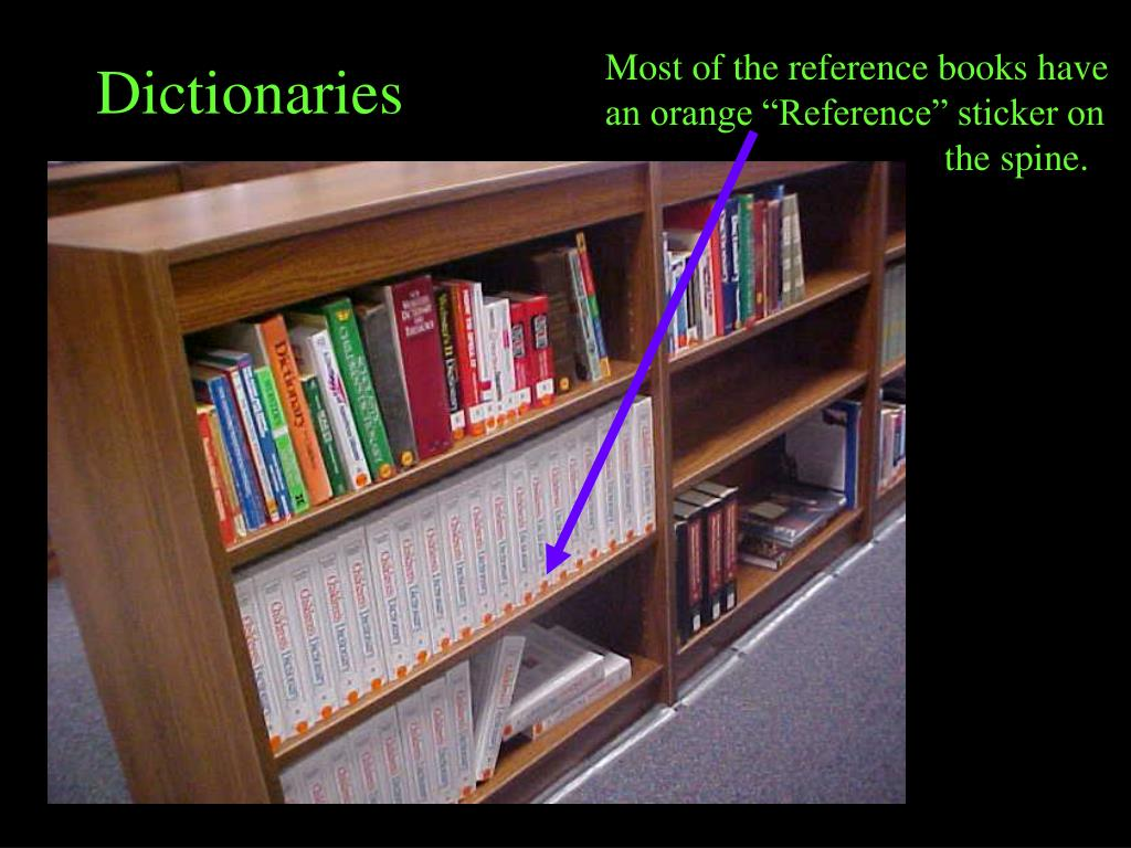 """Most of the reference books have an orange """"Reference"""" sticker on the spine."""