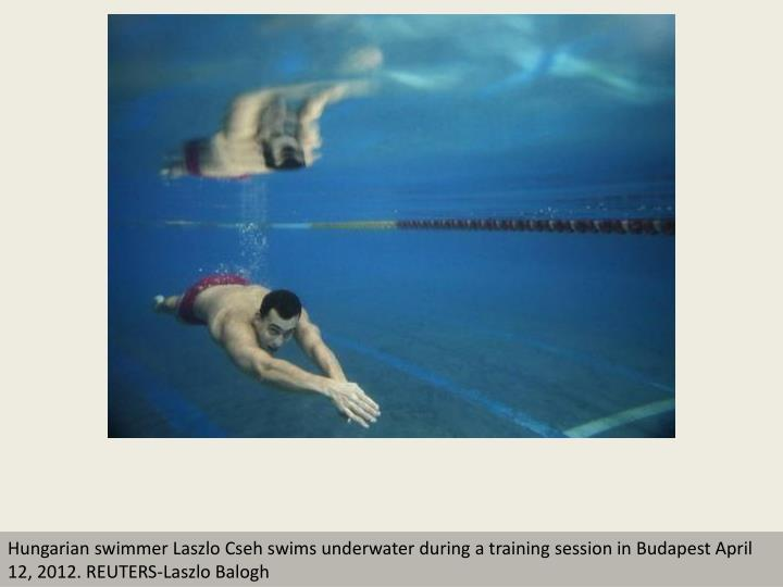 Hungarian swimmer Laszlo Cseh swims underwater during a training session in Budapest April 12, 2012....