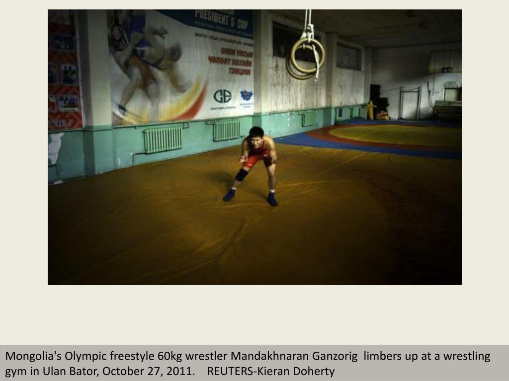 Mongolia's Olympic freestyle 60kg wrestler Mandakhnaran Ganzorig  limbers up at a wrestling gym in Ulan Bator, October 27, 2011.    REUTERS-Kieran Doherty