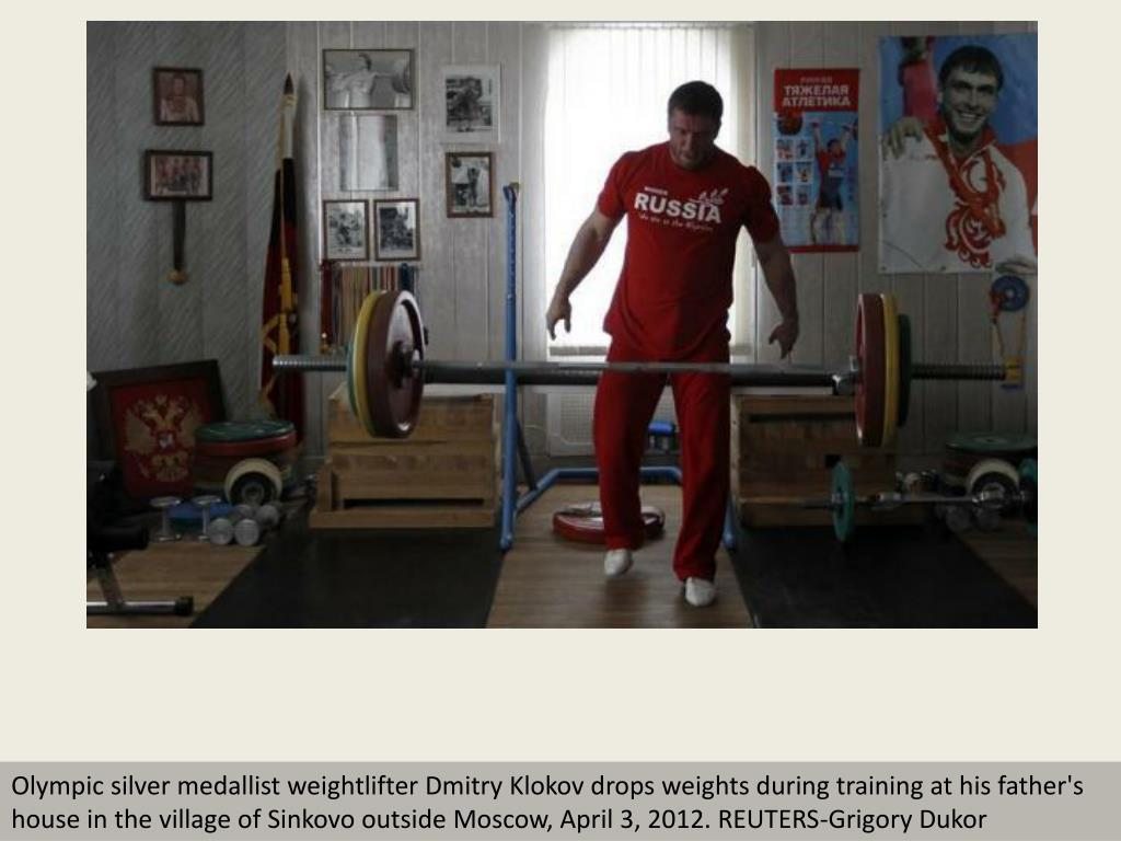 Olympic silver medallist weightlifter Dmitry Klokov drops weights during training at his father's house in the village of Sinkovo outside Moscow, April 3, 2012. REUTERS-Grigory Dukor