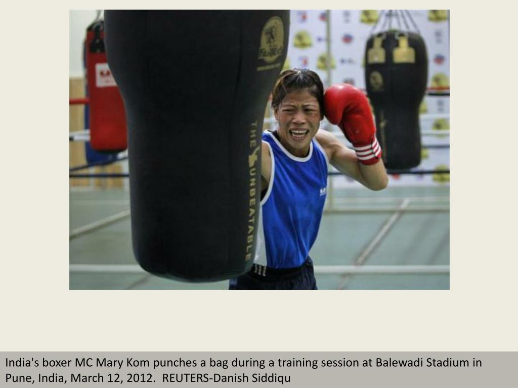 India's boxer MC Mary Kom punches a bag during a training session at Balewadi Stadium in Pune, India, March 12, 2012.  REUTERS-Danish Siddiqu