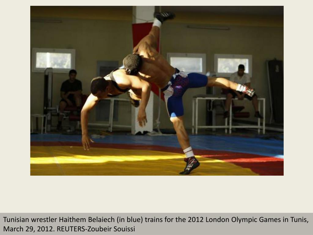 Tunisian wrestler Haithem Belaiech (in blue) trains for the 2012 London Olympic Games in Tunis,  March 29, 2012. REUTERS-Zoubeir Souissi
