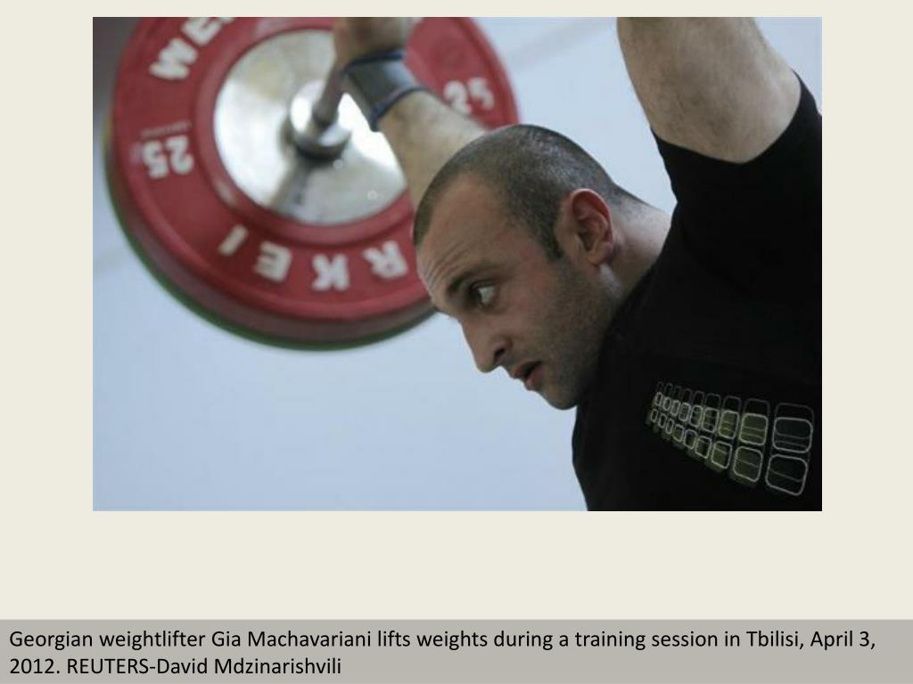 Georgian weightlifter Gia Machavariani lifts weights during a training session in Tbilisi, April 3, 2012. REUTERS-David Mdzinarishvili