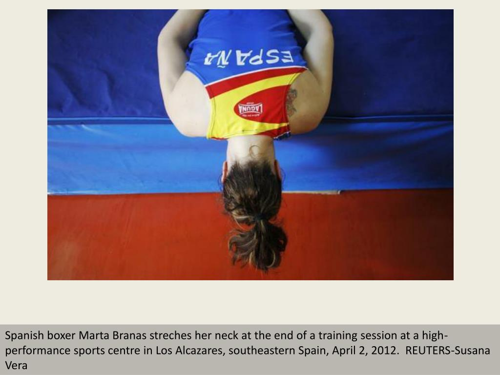 Spanish boxer Marta Branas streches her neck at the end of a training session at a high-performance sports centre in Los Alcazares, southeastern Spain, April 2, 2012.  REUTERS-Susana Vera