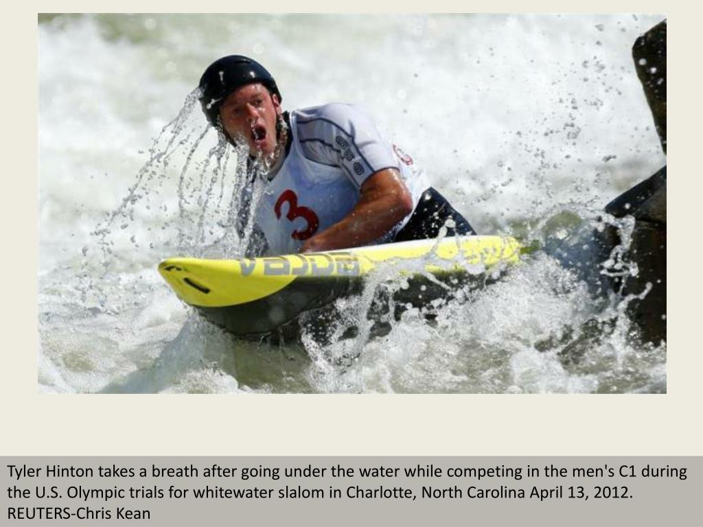 Tyler Hinton takes a breath after going under the water while competing in the men's C1 during the U.S. Olympic trials for whitewater slalom in Charlotte, North Carolina April 13, 2012. REUTERS-Chris Kean