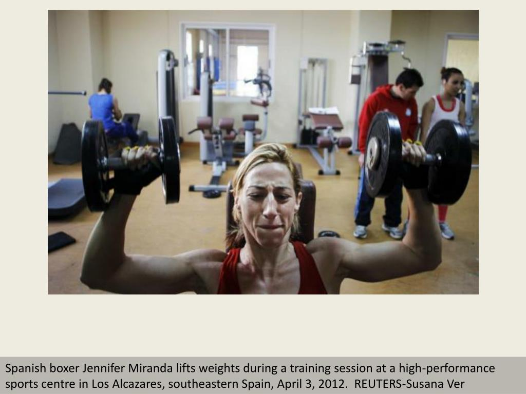Spanish boxer Jennifer Miranda lifts weights during a training session at a high-performance sports centre in Los Alcazares, southeastern Spain, April 3, 2012.  REUTERS-Susana Ver
