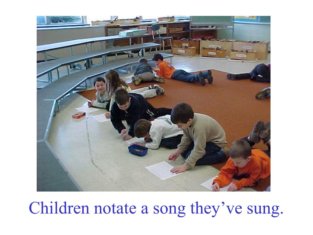 Children notate a song they've sung.
