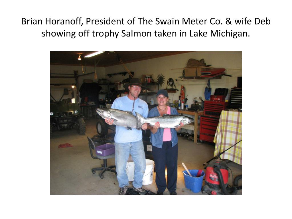 Brian Horanoff, President of The Swain Meter Co. & wife Deb showing off trophy Salmon taken in Lake Michigan.
