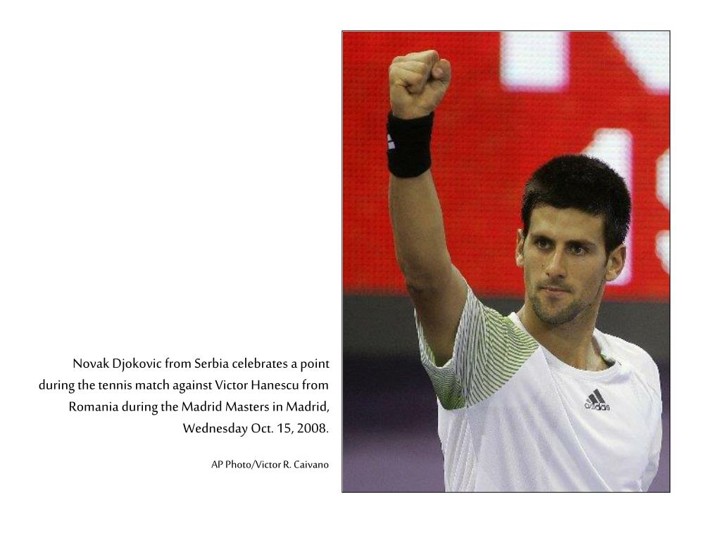 Novak Djokovic from Serbia celebrates a point during the tennis match against Victor Hanescu from Romania during the Madrid Masters in Madrid, Wednesday Oct. 15, 2008.