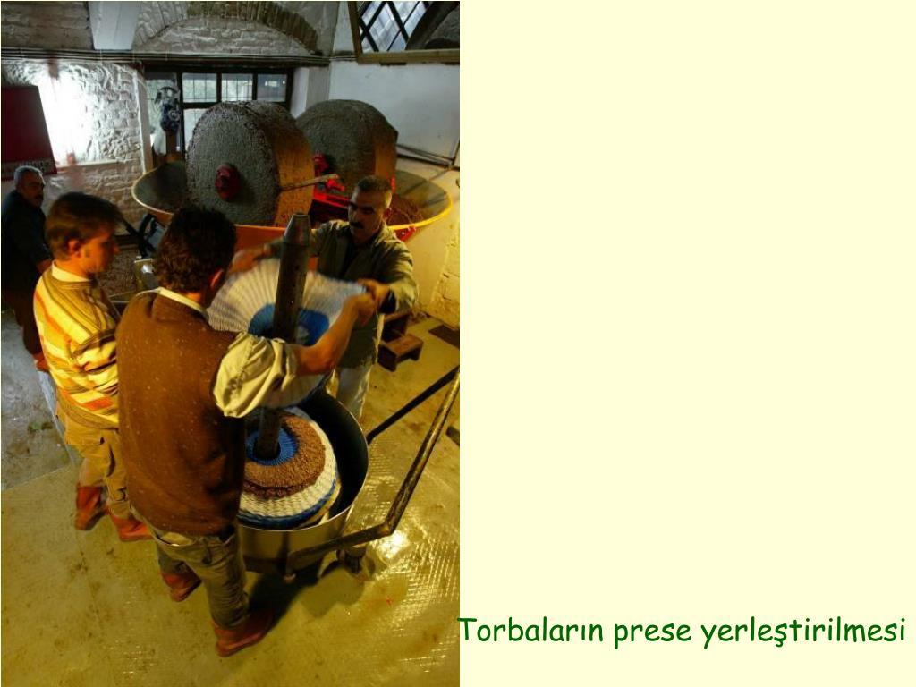 Torbaların prese yerleştirilmesi