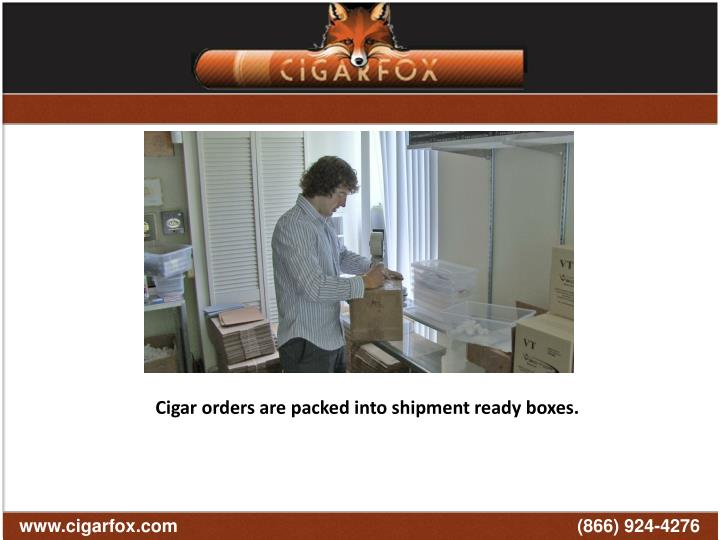 Cigar orders are packed into shipment ready boxes.