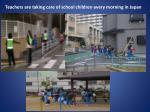teachers are taking care of school children every morning in japan