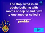 the hopi lived in an adobe building with rooms on top of and next to one another called a