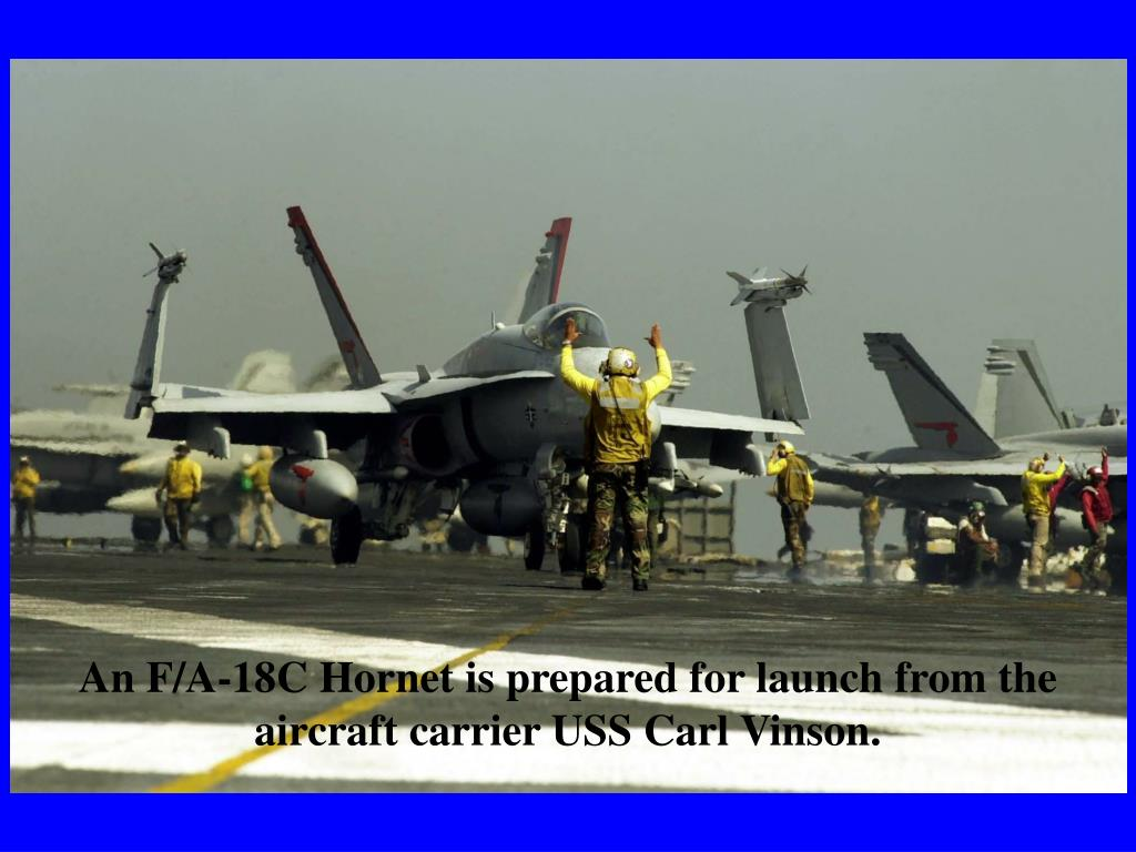 An F/A-18C Hornet is prepared for launch from the aircraft carrier USS Carl Vinson.
