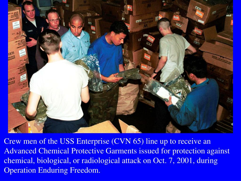 Crew men of the USS Enterprise (CVN 65) line up to receive an Advanced Chemical Protective Garments issued for protection against chemical, biological, or radiological attack on Oct. 7, 2001, during Operation Enduring Freedom.