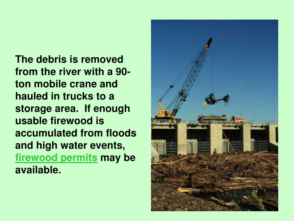 The debris is removed from the river with a 90-ton mobile crane and hauled in trucks to a storage area.  If enough usable firewood is accumulated from floods and high water events,
