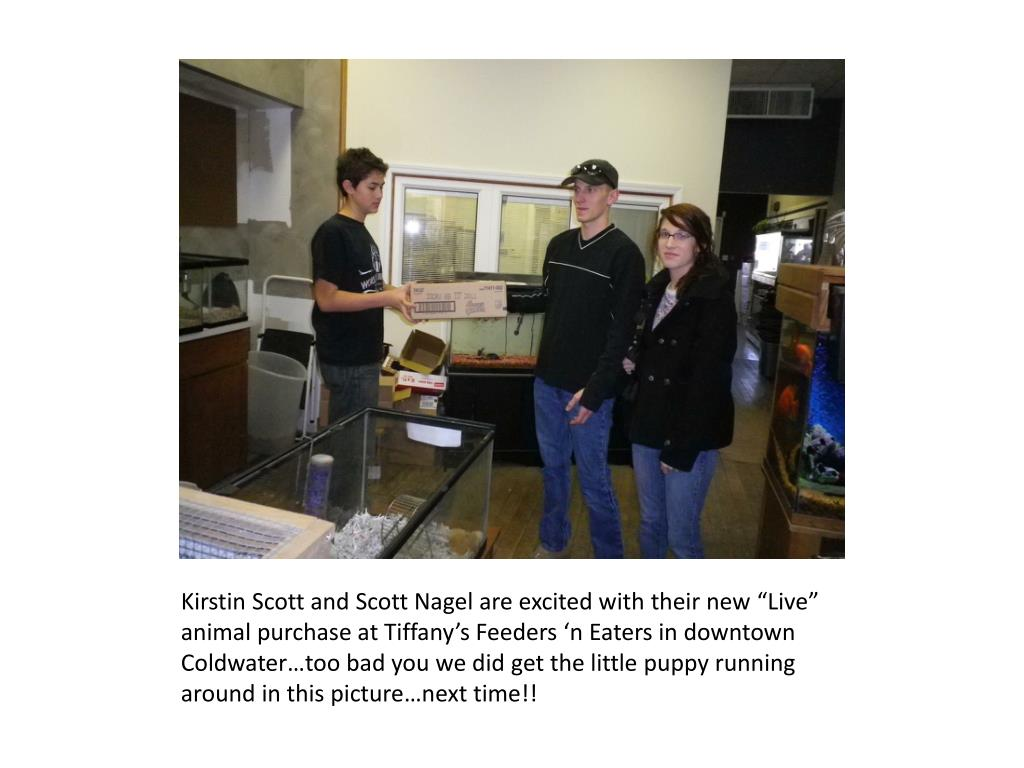 "Kirstin Scott and Scott Nagel are excited with their new ""Live"" animal purchase at Tiffany's Feeders 'n Eaters in downtown Coldwater…too bad you we did get the little puppy running around in this picture…next time!!"