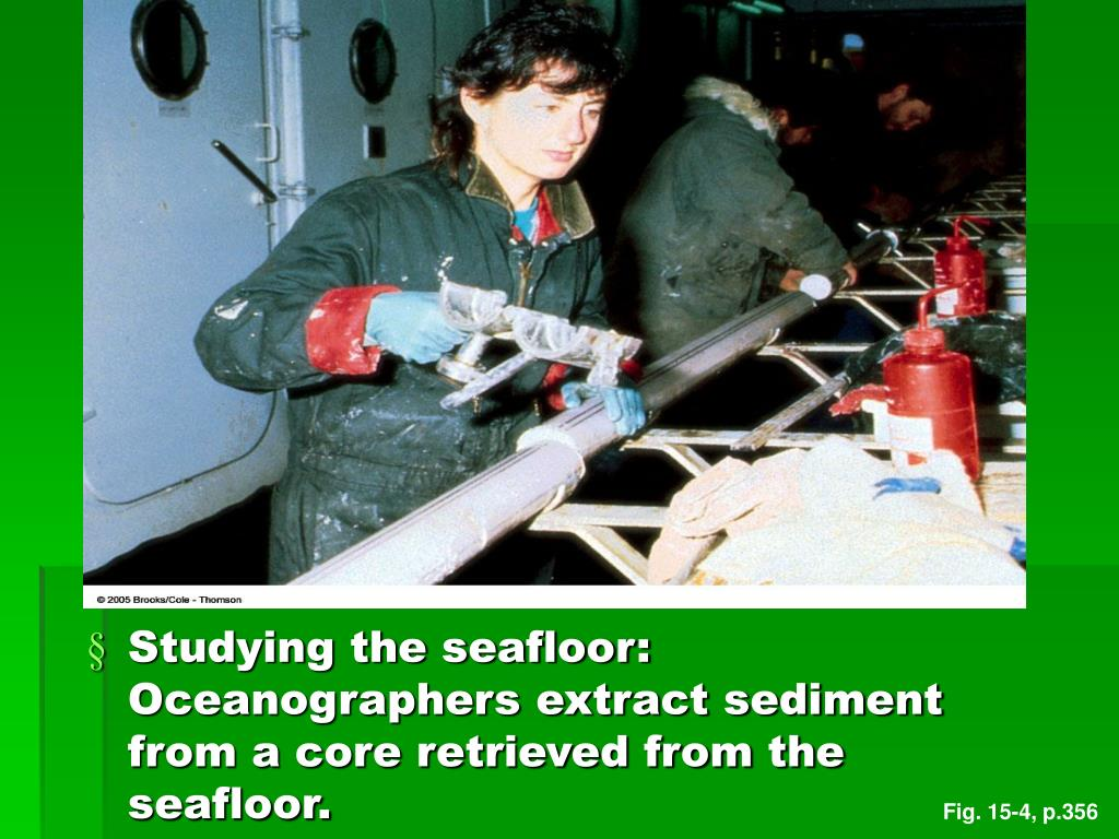 Studying the seafloor: Oceanographers extract sediment from a core retrieved from the seafloor.