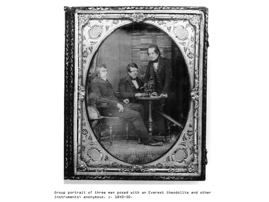 Group portrait of three men posed with an Everest theodolite and other instruments; anonymous,