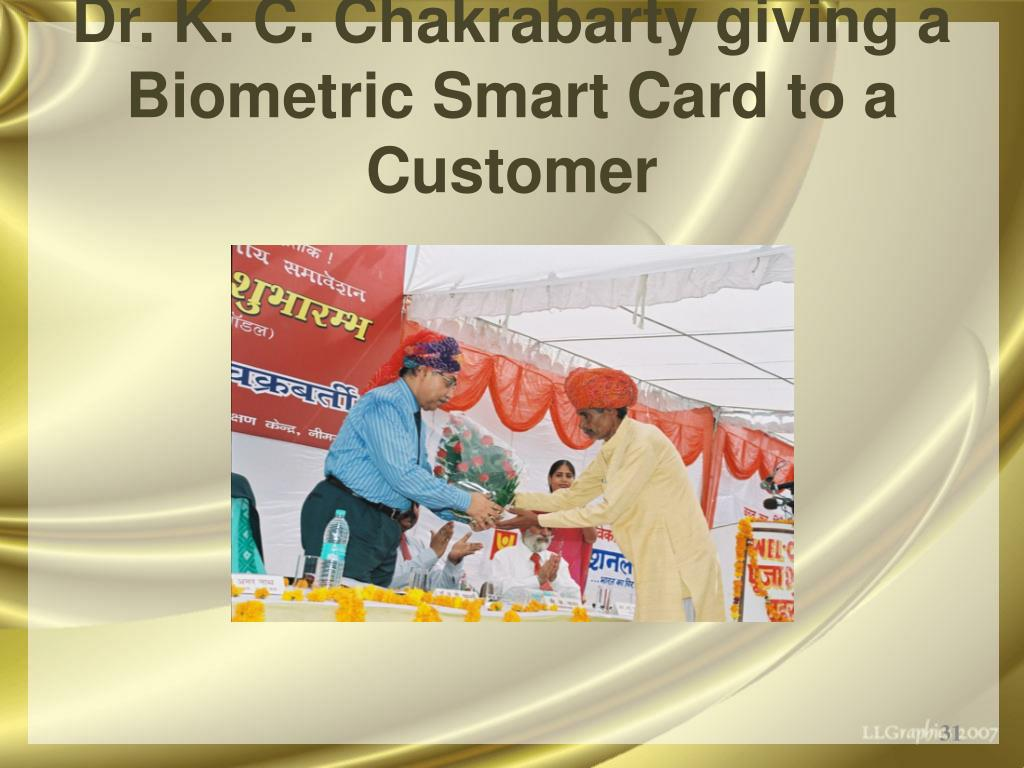 Dr. K. C. Chakrabarty giving a Biometric Smart Card to a Customer