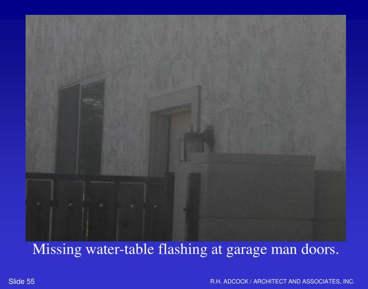 Missing water-table flashing at garage man doors.