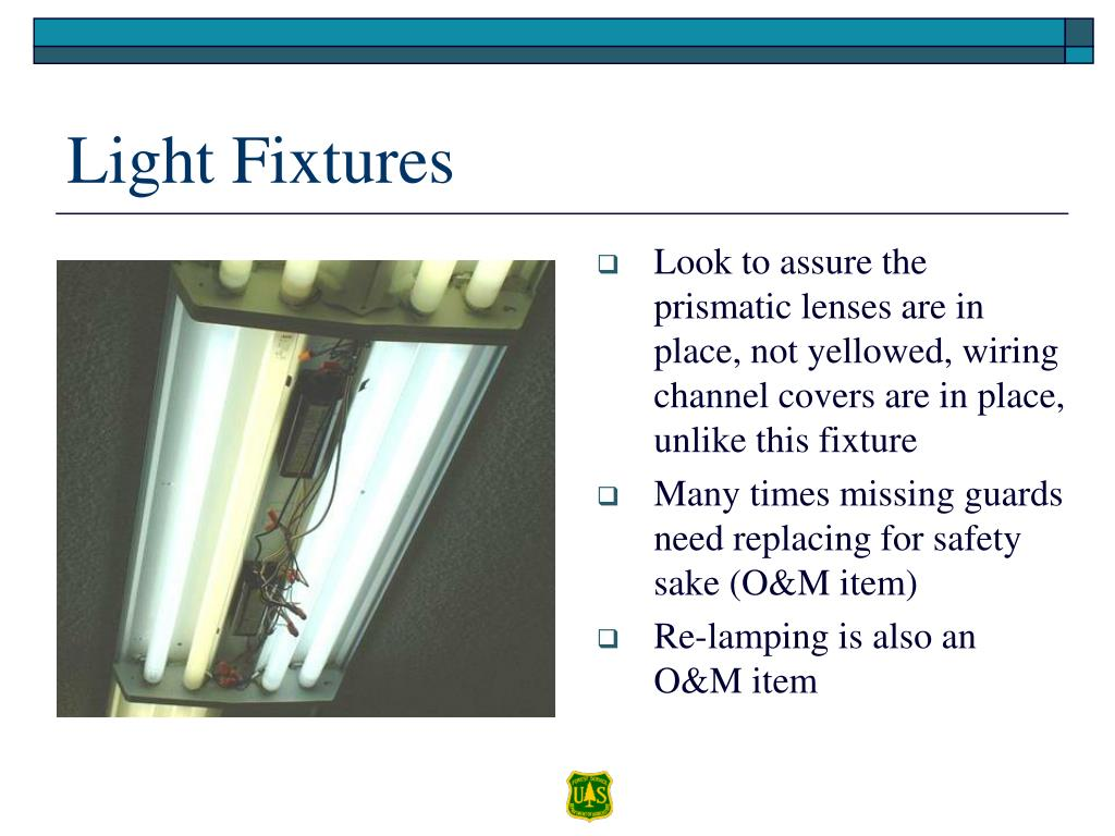 Look to assure the prismatic lenses are in place, not yellowed, wiring channel covers are in place, unlike this fixture