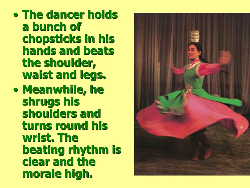 The dancer holds a bunch of chopsticks in his hands and beats the shoulder, waist and legs.