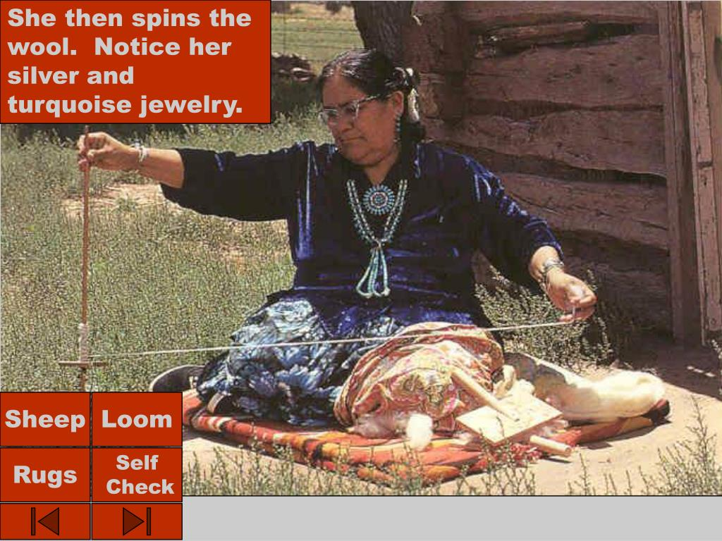 She then spins the wool.  Notice her silver and turquoise jewelry.