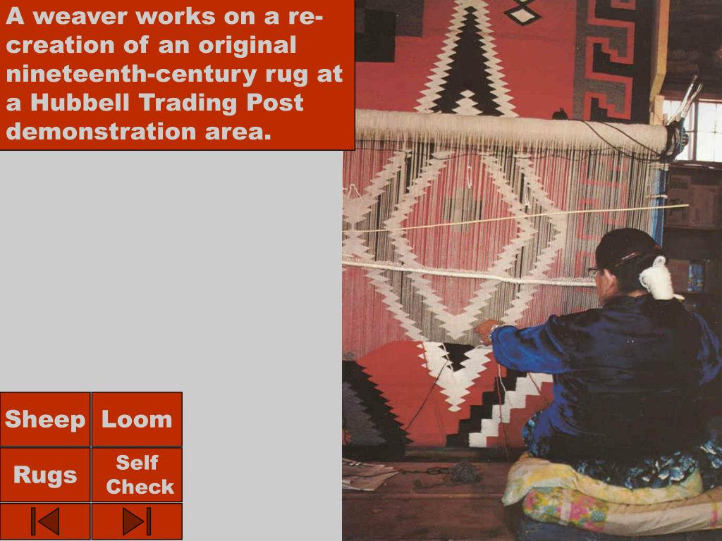 A weaver works on a re-creation of an original nineteenth-century rug at a Hubbell Trading Post demonstration area.