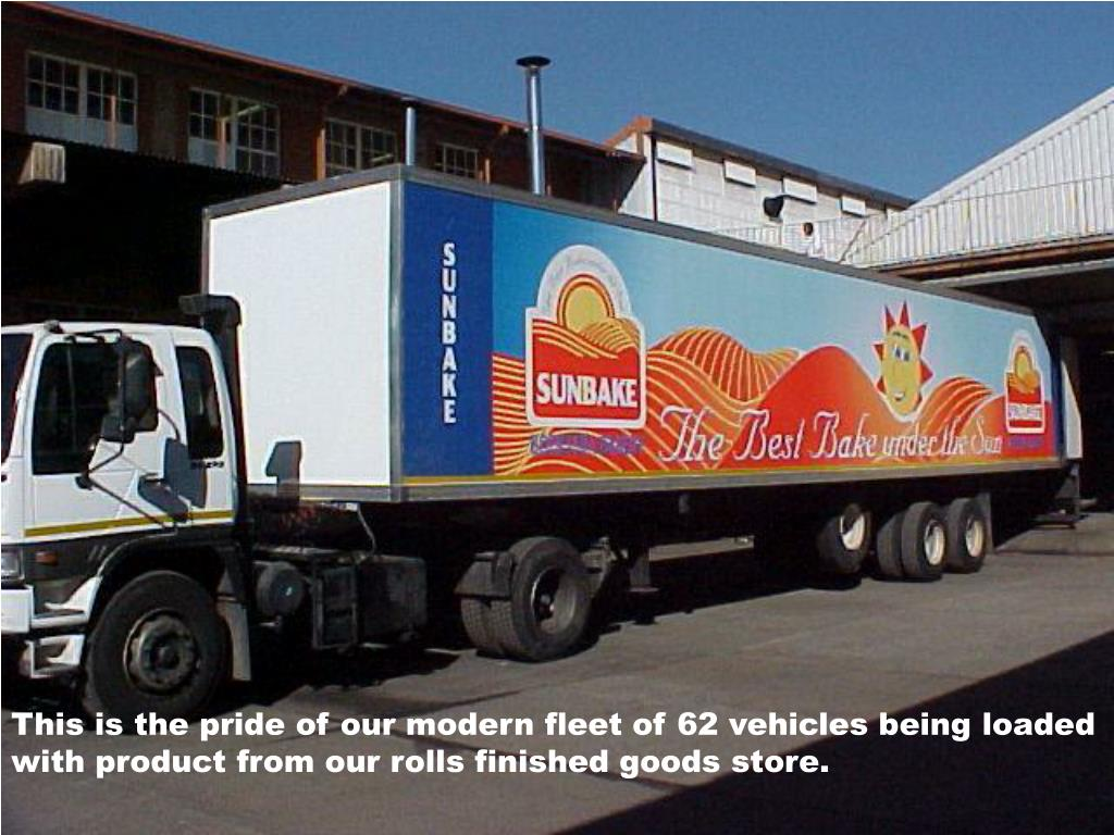 This is the pride of our modern fleet of 62 vehicles being loaded with product from our rolls finished goods store.
