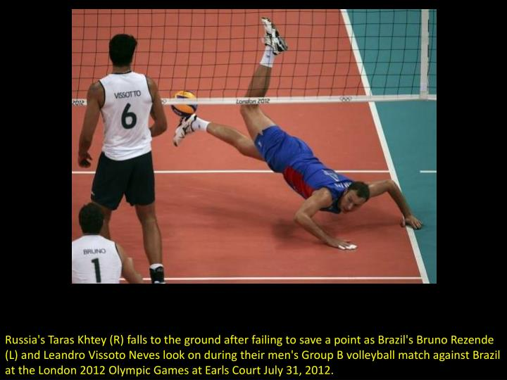 Russia's Taras Khtey (R) falls to the ground after failing to save a point as Brazil's Bruno Rezende...
