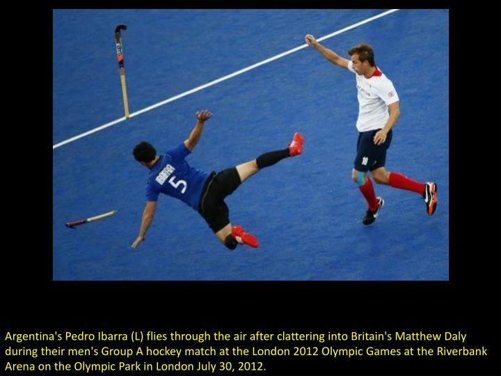 Argentina's Pedro Ibarra (L) flies through the air after clattering into Britain's Matthew Daly duri...