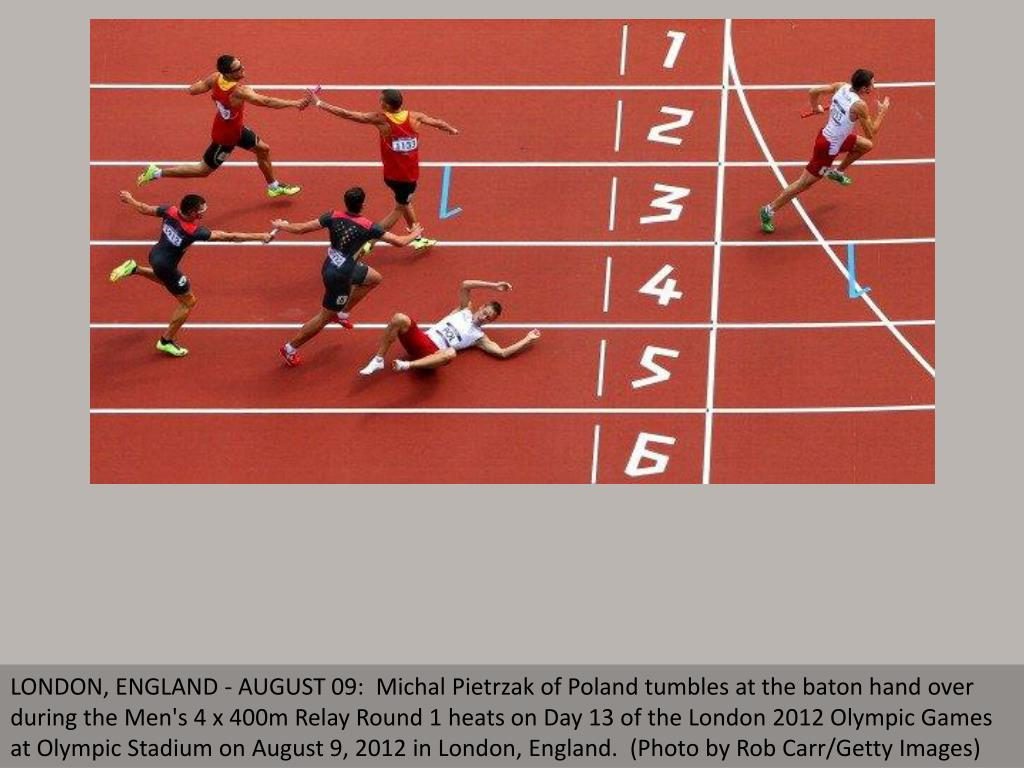 LONDON, ENGLAND - AUGUST 09:  Michal Pietrzak of Poland tumbles at the baton hand over during the Men's 4 x 400m Relay Round 1 heats on Day 13 of the London 2012 Olympic Games at Olympic Stadium on August 9, 2012 in London, England.  (Photo by Rob Carr/Getty Images)