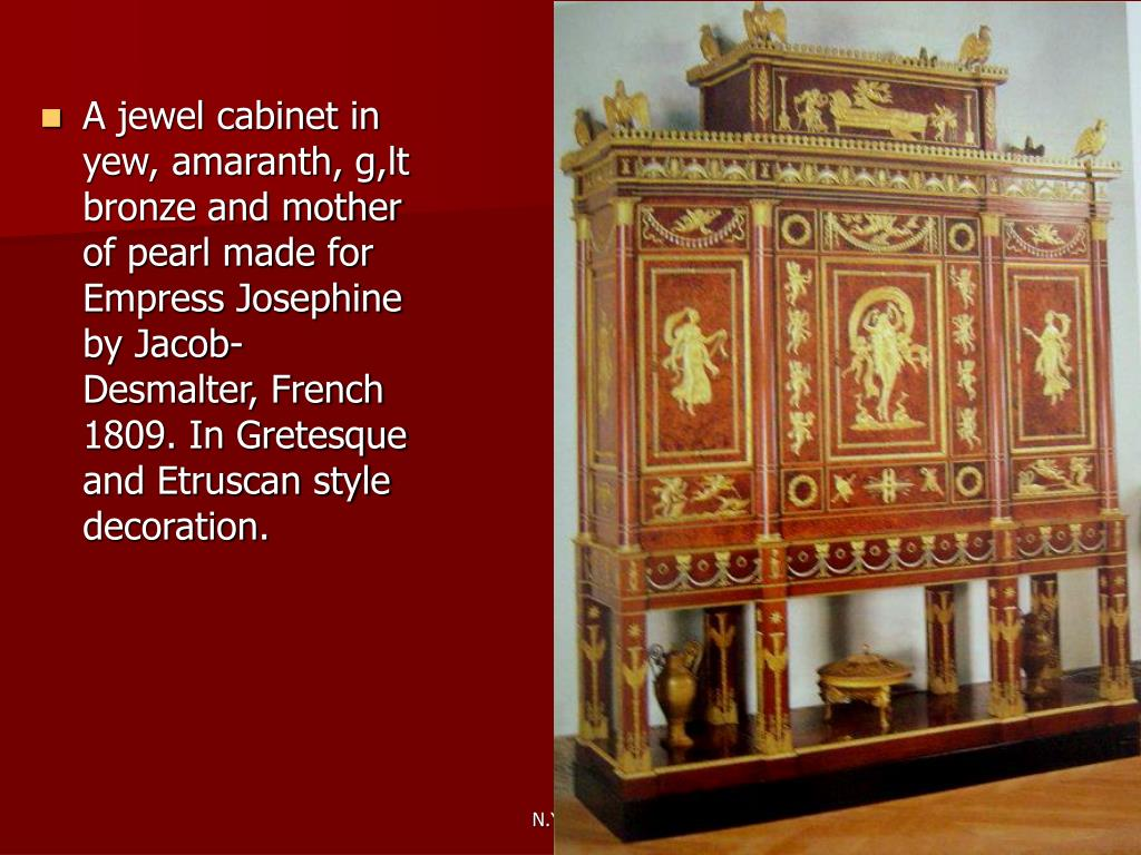 A jewel cabinet in yew, amaranth, g,lt bronze and mother of pearl made for Empress Josephine by Jacob-Desmalter, French 1809. In Gretesque and Etruscan style decoration.