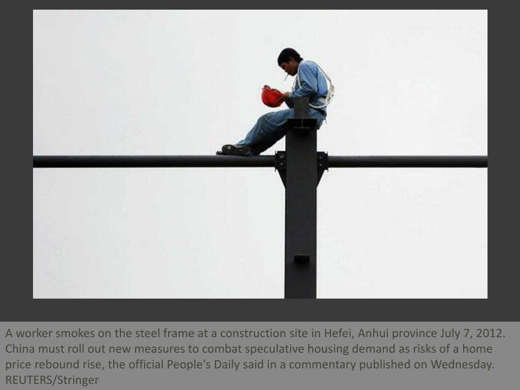 A worker smokes on the steel frame at a construction site in Hefei, Anhui province July 7, 2012. China must roll out new measures to combat speculative housing demand as risks of a home price rebound rise, the official People's Daily said in a commentary published on Wednesday. REUTERS/Stringer