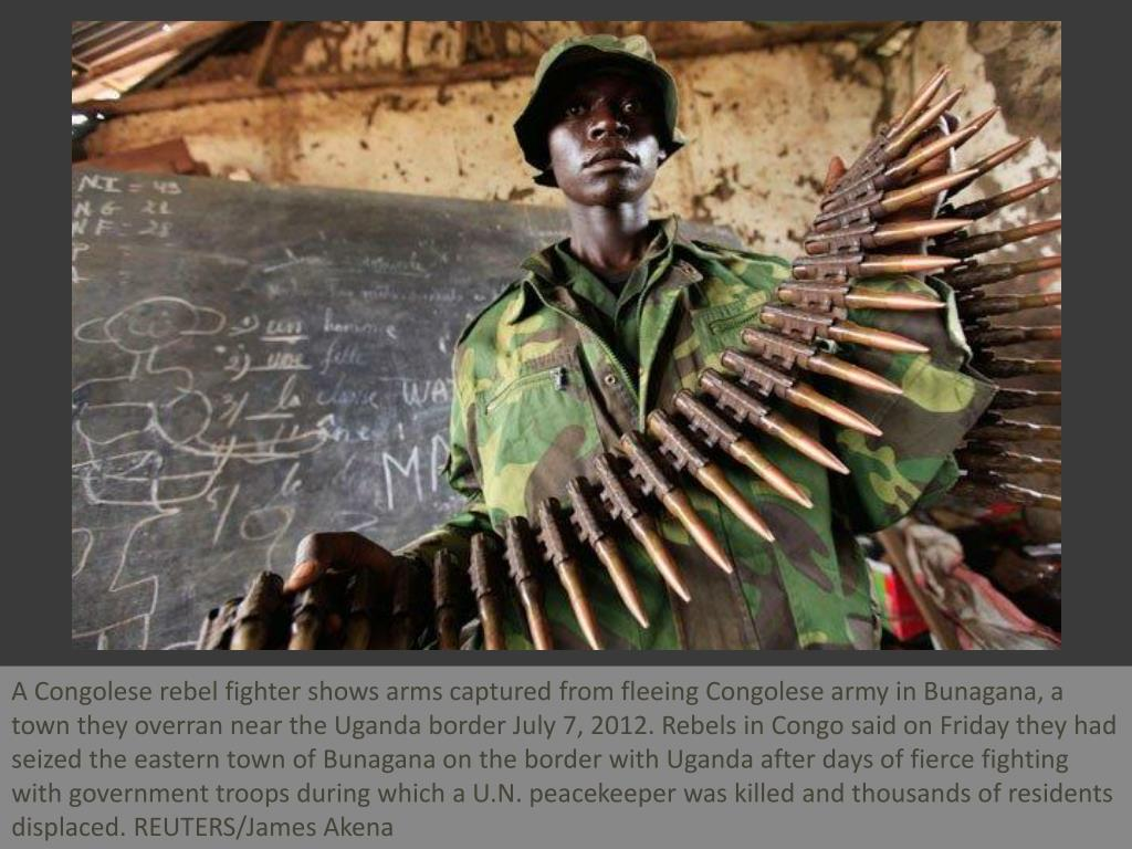 A Congolese rebel fighter shows arms captured from fleeing Congolese army in Bunagana, a town they overran near the Uganda border July 7, 2012. Rebels in Congo said on Friday they had seized the eastern town of Bunagana on the border with Uganda after days of fierce fighting with government troops during which a U.N. peacekeeper was killed and thousands of residents displaced. REUTERS/James Akena
