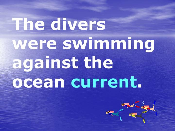 The divers were swimming against the ocean