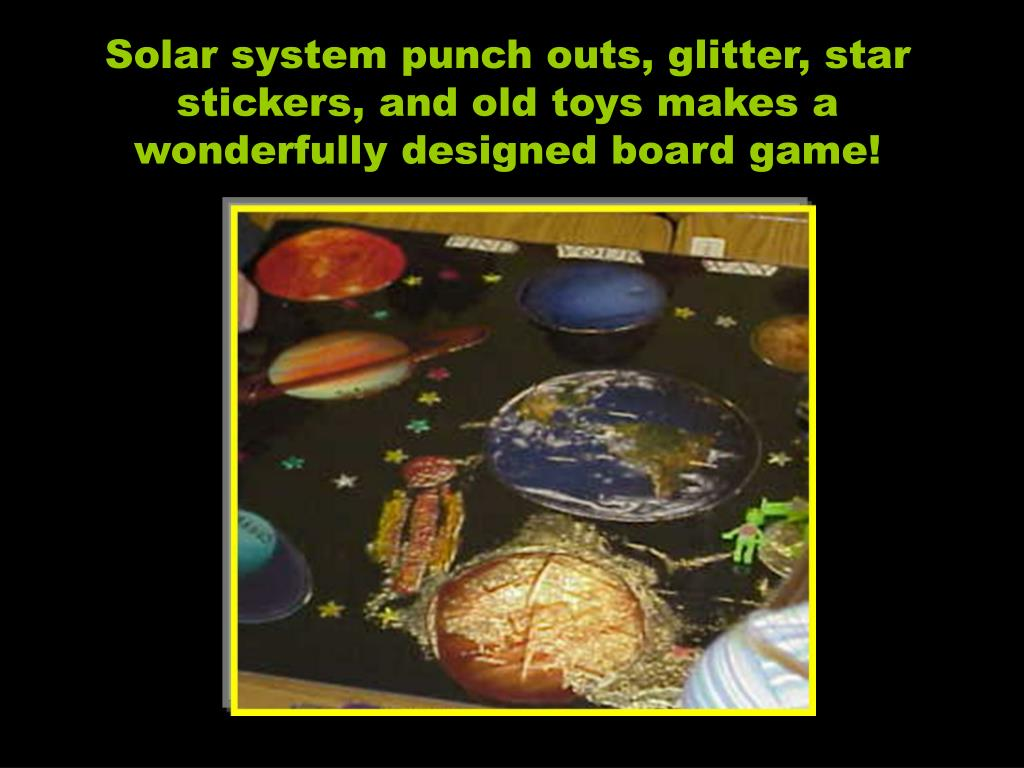 Solar system punch outs, glitter, star stickers, and old toys makes a wonderfully designed board game!