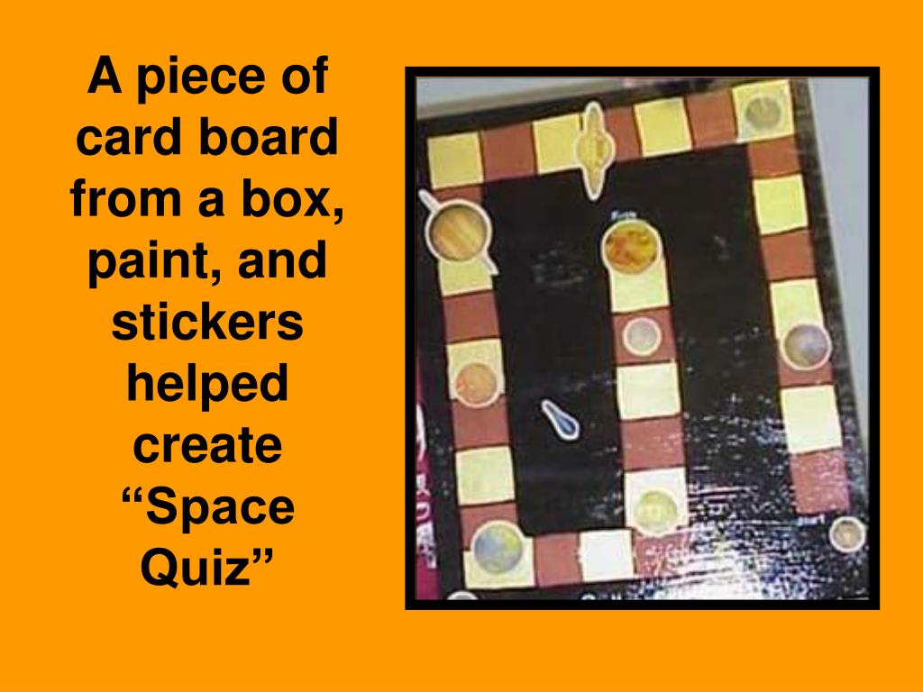 """A piece of card board  from a box, paint, and stickers helped create """"Space Quiz"""""""