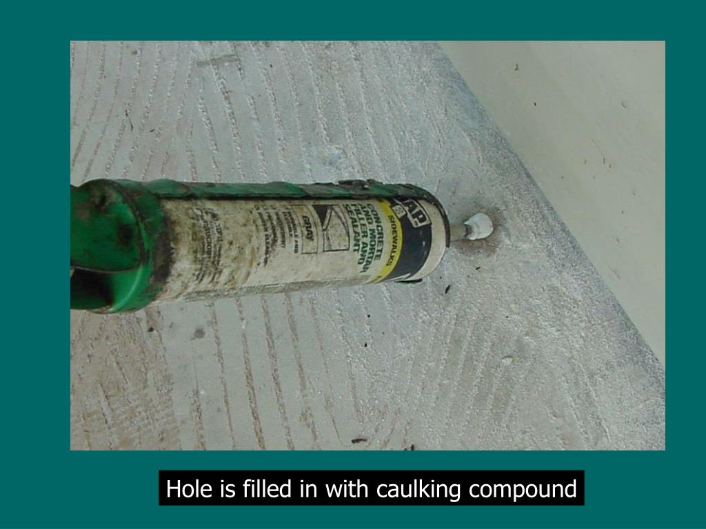 Hole is filled in with caulking compound