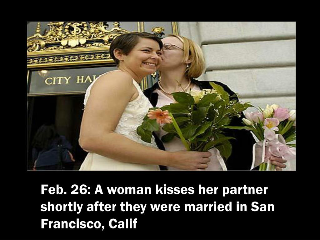 Feb. 26: A woman kisses her partner shortly after they were married in San Francisco, Calif