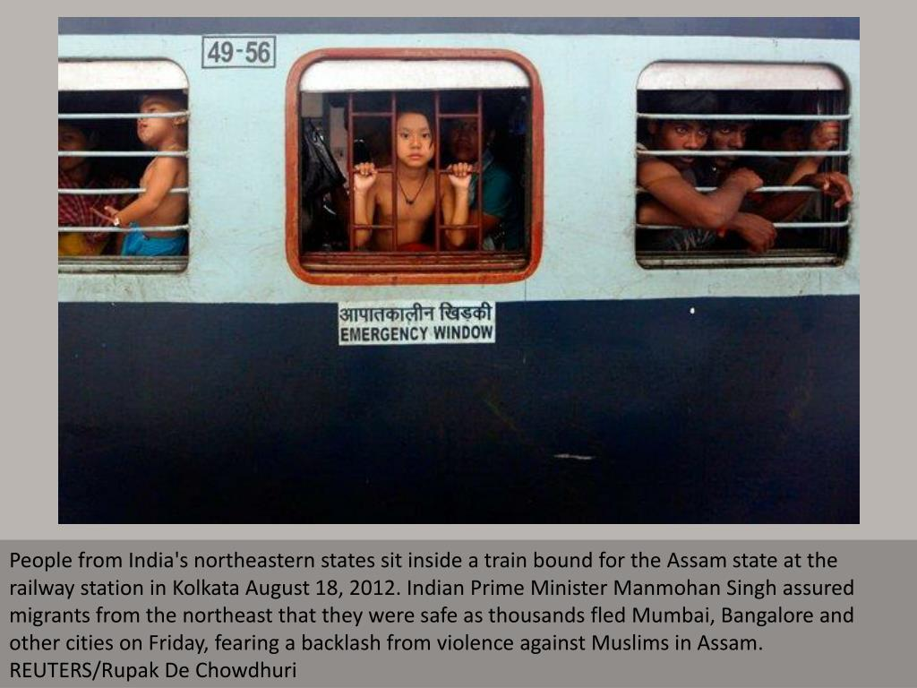 People from India's northeastern states sit inside a train bound for the Assam state at the railway station in Kolkata August 18, 2012. Indian Prime Minister Manmohan Singh assured migrants from the northeast that they were safe as thousands fled Mumbai, Bangalore and other cities on Friday, fearing a backlash from violence against Muslims in Assam. REUTERS/Rupak De Chowdhuri