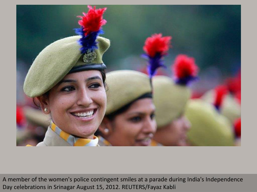 A member of the women's police contingent smiles at a parade during India's Independence Day celebrations in Srinagar August 15, 2012. REUTERS/Fayaz Kabli