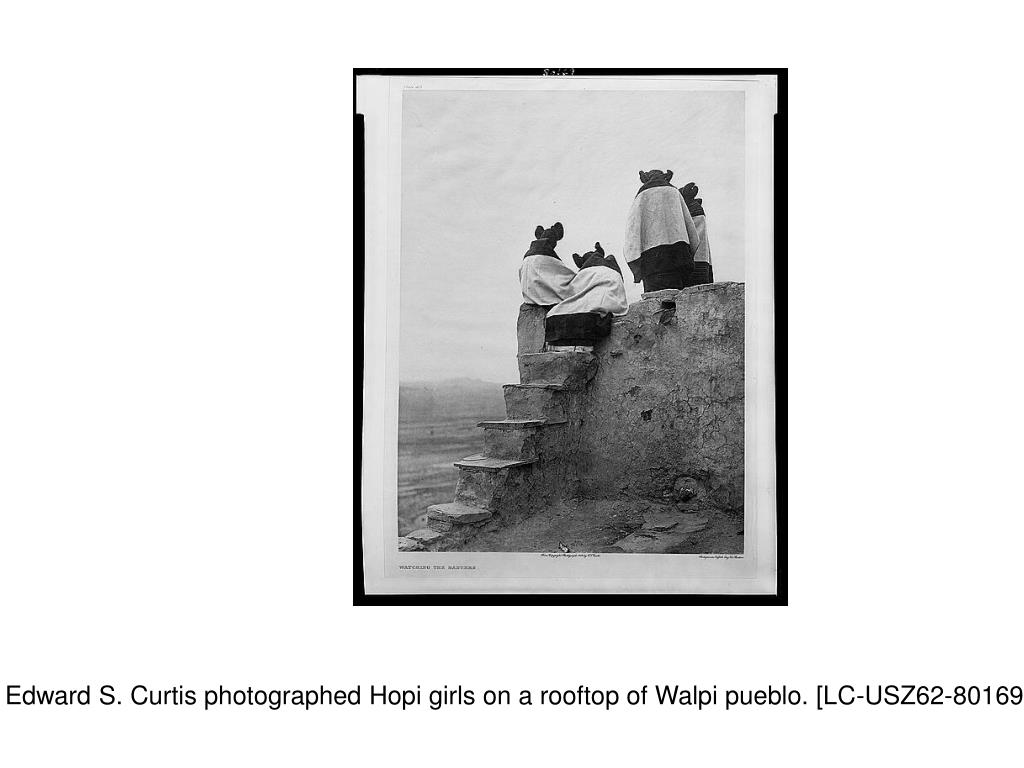 """1906 work """"Watching the Dancers,"""" Edward S. Curtis photographed Hopi girls on a rooftop of Walpi pueblo. [LC-USZ62-80169 (black & white film copy negative)]"""