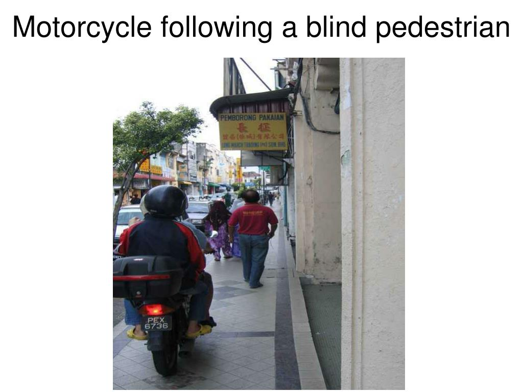 Motorcycle following a blind pedestrian