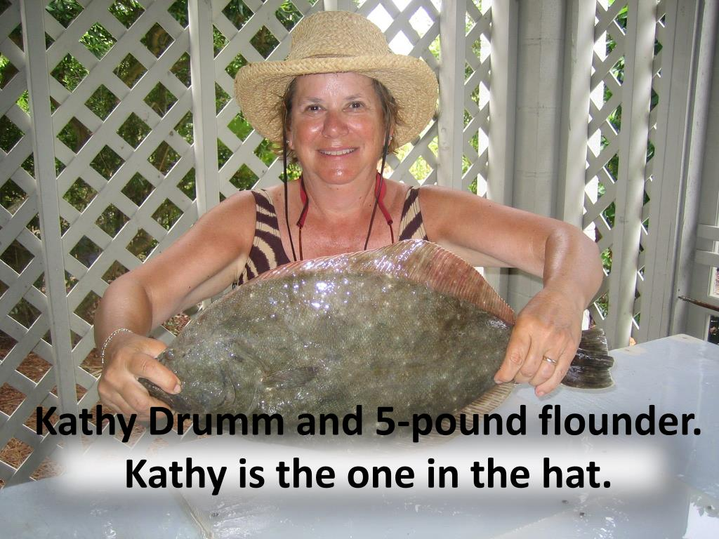 Kathy Drumm and 5-pound flounder.  Kathy is the one in the hat.