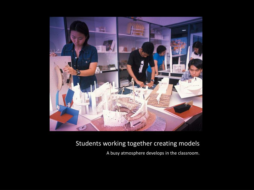 Students working together creating models