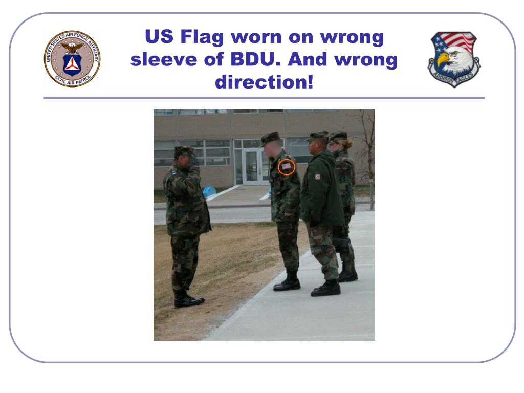 US Flag worn on wrong sleeve of BDU. And wrong direction!