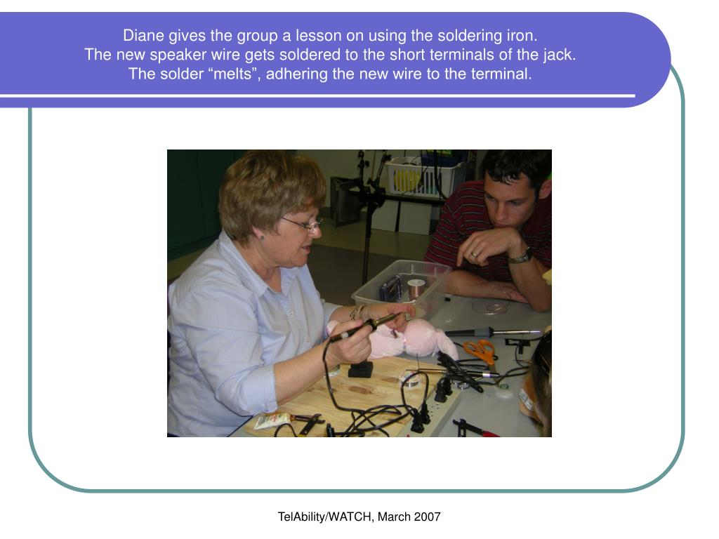 Diane gives the group a lesson on using the soldering iron.